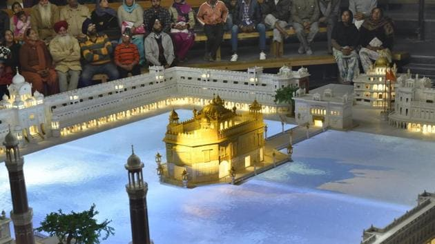 Visitors experiencing the newly opened hi-tech basement of the Golden Temple plaza in Amritsar on Wednesday.(Gurpreet Singh/HT Photo)