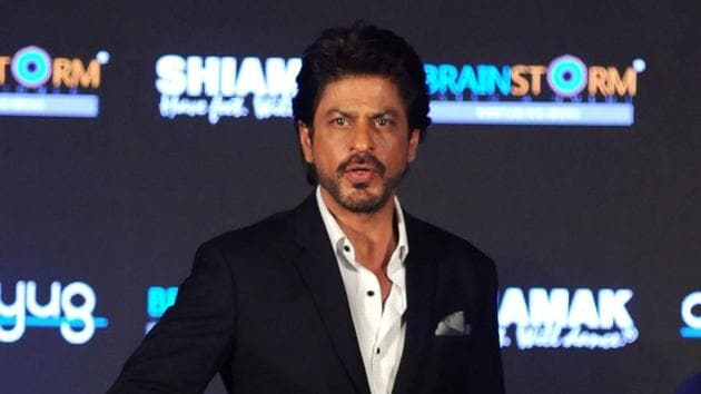 Shah Rukh Khan gestures during the launching and press conference of 'Indian Academy Awards' (IAA) in Mumbai.(AFP)