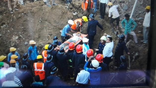 Rescures pull out a worker from the debris at a construction site in Patlipada on Friday(Praful Gangurde)