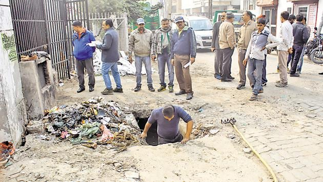 A B Ed degree holder, Buddhi Sagar, had to clean a manhole to get selected for the post of sanitation worker in Lucknow.(HT Photo)