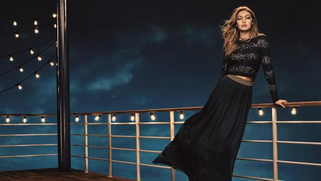 The mohair sweater with sequins and long pleated silk chiffon skirt from the capsule collection designed by Gigi Hadid for Tommy Hilfiger make a winning combination for Holiday 2016.(Mango)