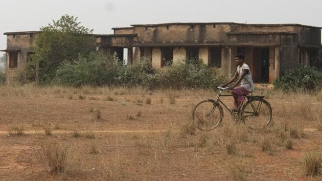 Bahragora (Jharkhand)(FILE PIX)A villager crossing through the dipalpitated non functioning health centre at village Rampur in Bahragora at West Singhbhum ( Photo by Parwaz Khan/ Hindustan Times) Story Saumya Mishra