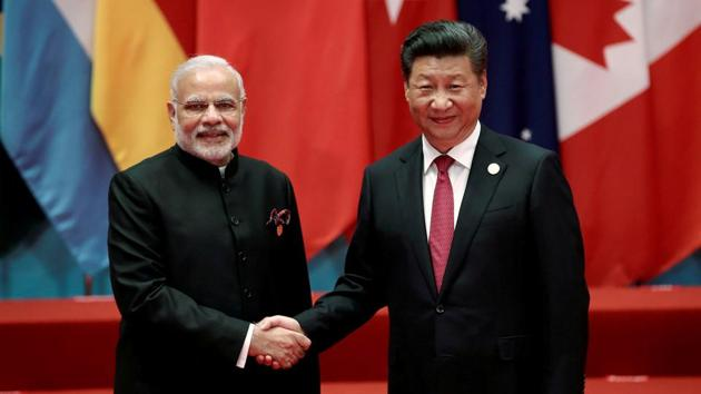 Chinese President Xi Jinping shakes hands with Indian Prime Minister Narendra Modi during the G20 Summit in China in September 2016. Chinese state-run Global Times suggested India to accept the 'olive branch' extended by a Pakistan general and join CPEC.(Reuters file photo)