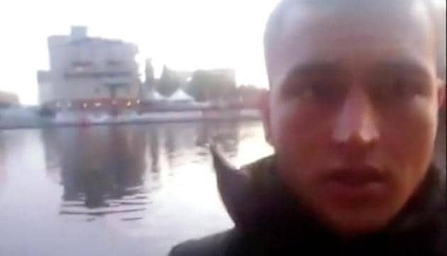 A still image taken from a short 'selfie' video clip from a social media website purportedly shows Anis Amri, the Tunisian suspect of the Berlin Christmas market attack, at an unknown location.(Social Media/via Reuters TV)