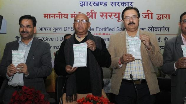 Jharkhand food and civil supplies minister Saryu Rai along with officials of the department launches double fortified salt at a function in Ranchi(Diwakar Prasad/ Hindustan Times)