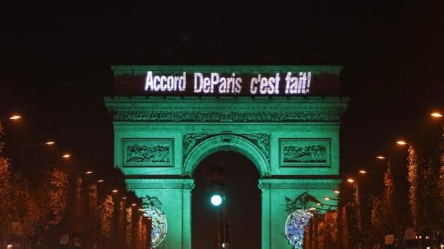 The Arc de Triomphe (Arch of Triumph) illuminated with the letters reading 'The Paris accord is done' to celebrate the first day of the application of the Paris COP21 climate accord in November.(AFP file photo)