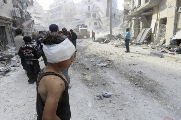 This image released by Thiqa News Agency shows an injured child after airstrikes in Aleppo, Syria on Nov 16, 2016. The Syrian Observatory for Human Rights said 88 people were killed in 24 hours in an Islamic State-held Syrian town of Al-Bab, making it the bloodiest attack by Turkish forces that his monitoring group had recorded since Ankara began its intervention in Syria in late August.(AP file photo)