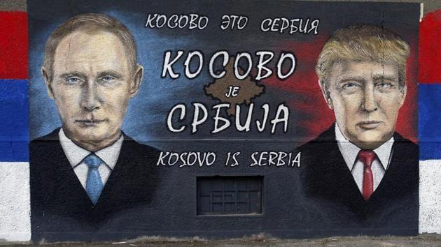A graffiti depicting the Russian President Vladimir Putin and US president-elect Donald Trump in a suburb of Belgrade, Serbia.(AP File Photo)