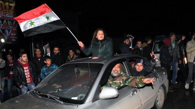 Syrians celebrate on December 22, 2016 in the northern Syrian city of Aleppo, after the army said it has retaken full control of the country's second city The army said it has retaken full control of Syria's devastated second city Aleppo, scoring its biggest victory against opposition forces since the civil war erupted in 2011.(AFP)