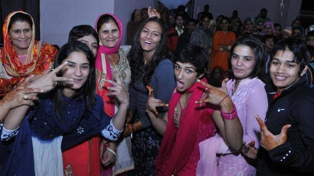 Like any other teenage girl, the Phogat sisters too fancied long hair, but Geeta's father, wrestling's Dronacharya Mahavir Singh Phogat, was a hard taskmaster(HT Photo/Keshav Singh)