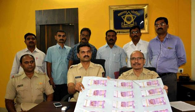 Every day, India is witness to law-enforcement agencies seizing bundles of the distinctive, pink bundles of Rs 2,000-denomination bank notes(HT Photo)