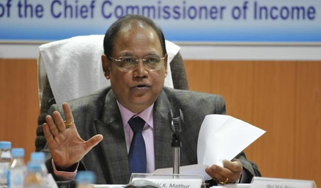 Chief income tax commissioner Vinod Kumar Mathur talks at a press meet in Indore on Friday.(Arun Mondhe/HT photo)