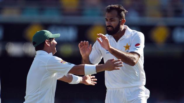 Pakistan's paceman Wahab Riaz (R) celebrates his wicket of Australia's batsman Matt Renshaw during the first day-night cricket Test against Australia.(AFP)