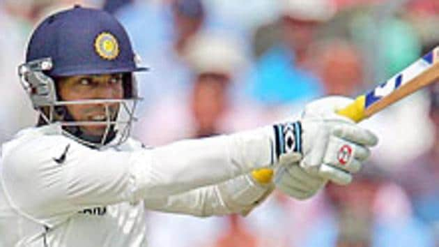 Dinesh Karthik, who became the second Tamil Nadu player to play 100 First-Class matches, played a vital knock to defeat Karnataka.(HT Photo)