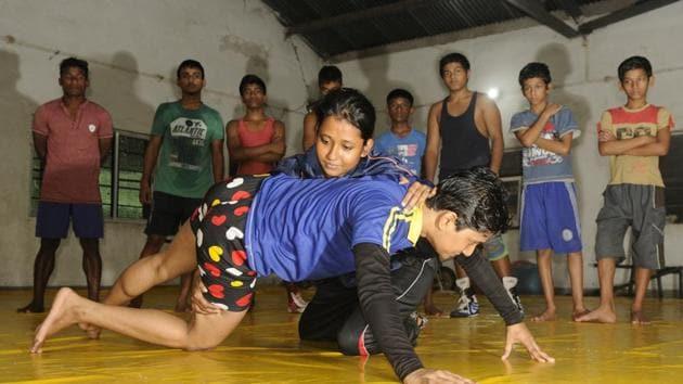 Women wrestlers practising at Panchanan Bayam Samiti, one of the few wrestling clubs for women in Bengal.(Samir Jana)