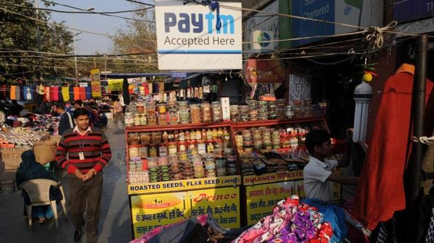 A Paytm signboard can be seen near the shop of a bangle seller. Mobile walets such as Paytm allowing cashless transactions have witnessed a surge in business after the government's note ban exercise.(Burhaan Kinu/HT PHOTO)
