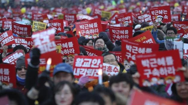 Protesters shout slogans during a rally calling for South Korean President Park Geun-hye to step down in Seoul, South Korea, Saturday.(AP Photo)