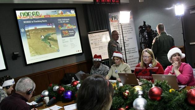 In this December 24, 2012, file photo, volunteers take phone calls from children asking where Santa is and when he will deliver presents to their house, during the annual NORAD Tracks Santa Operation, at the North American Aerospace Defense Command, or NORAD, at Peterson Air Force Base, in Colorado Springs.(AP Photo)