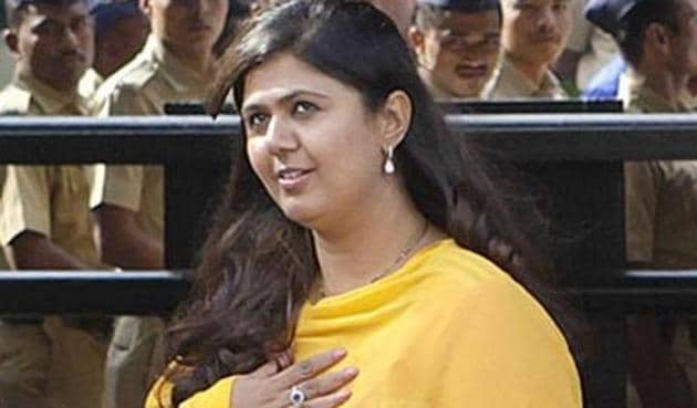 State women and child development minister Pankaja Munde's sister Pritam, who is a BJP MP, is a director of the bank.(HT File)