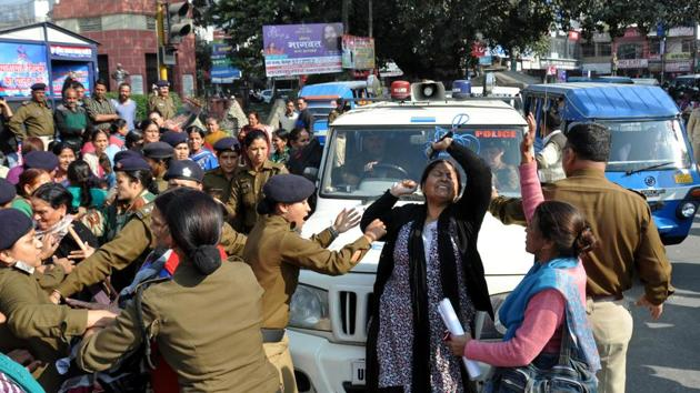 Agitators demanding declaration of Gairsain as the permanent capital of Uttarakhand protest at Clock Tower in Dehradun.(HT FILE PHOTO)