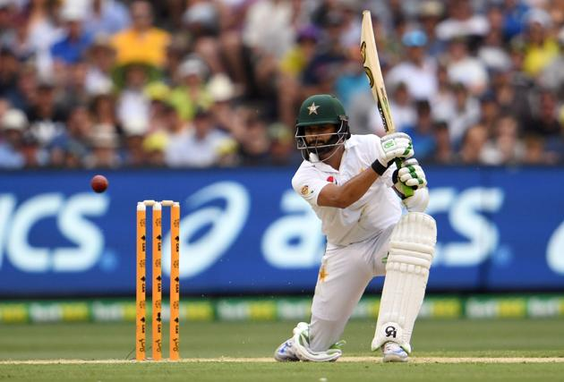 Pakistan batsman Azhar Ali drives a delivery from Australia's Josh Hazlewood on the first day of the second cricket Test match in Melbourne. Follow Live cricket score and ball-by-ball of Australia vs Pakistan here(AFP)