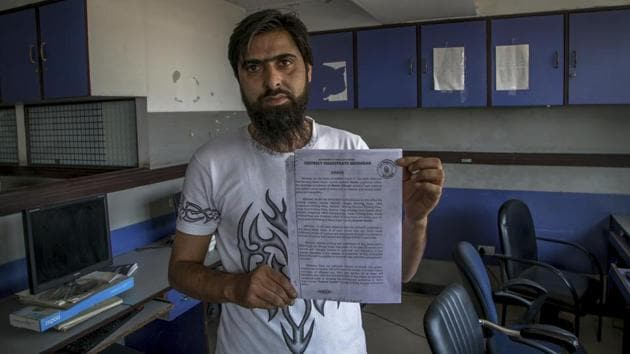 """Feroz Ahmed, manager of """"Kashmir Reader"""" newspaper shows a state government order in Srinagar on Oct. 4, 2016. The three-month ban on Kashmir Reader by the Jammu and Kashmir government was decided to be lifted on Monday.(AP file photo)"""