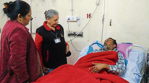 Volunteers of the Sahayta Charitable Welfare Society with cancer patients at the PGIMER, Chandigarh.(HT Photo)