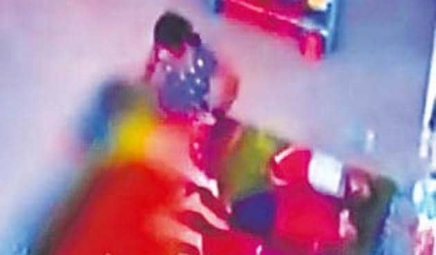 CCTV grab of the footage showing a nine-month-old girl being brutally assaulted by a domestic help on November 21 at the daycare centre.(HT Photo)