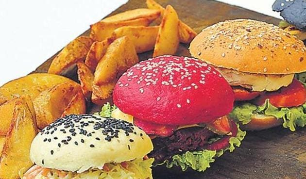A recent study has found that consumption of burgers, oily and fried food, salted snacks, dry fruits and nuts may be associated with asthma.(HT Photo)