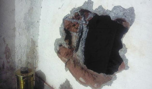 The hole that the thieves dug to steal the jewellery on the intervening night of Sunday and Monday.(HT Photo)
