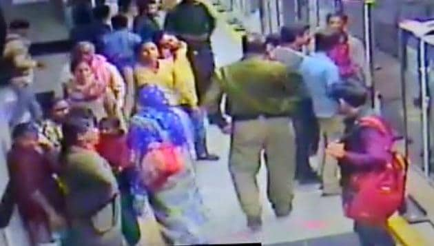 A grab of the CCTV footage shows the walking keeping something in his pocket that one of the women pickpockets had handed him over.(Handout)
