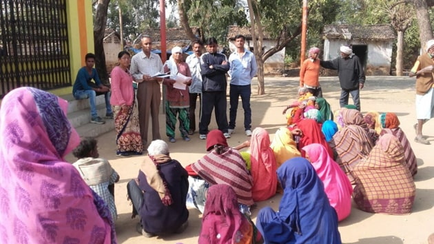 Nagar Uday se Bharat Uday officials interact with leprosy-affected families living in Ashagram premises in outskirts of Barwani on Tuesday.(HT photo)