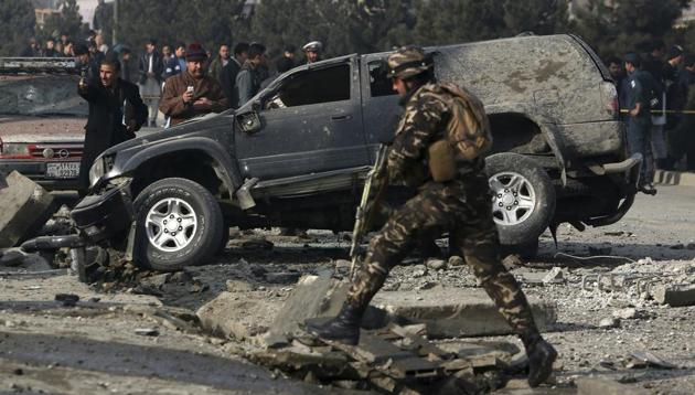 Afghan security personnel inspect at the site of roadside bomb blast in Kabul, Afghanistan. Afghan officials say that at least three people have been wounded by a roadside bomb blast in the capital, Kabul.(AP Photo)