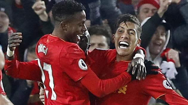 Liverpool F.C moved to second spot in the Premier League with a 4-1 thrashing of Stoke City F.C.(AP)