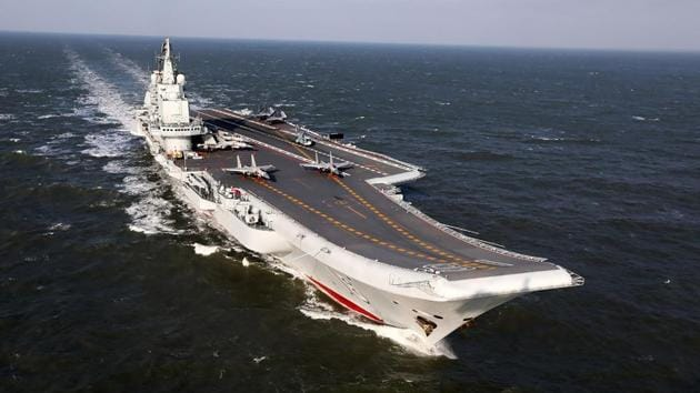 This photo shows the Liaoning, China's only aircraft carrier, sailing during military drills in the Pacific.(AFP Photo)