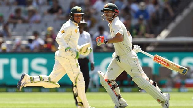 David Warner blasted his 17th century and shared a magnificent 198-run stand for the second wicket with Usman Khawaja after Azhar Ali smashed an unbeaten 205 in Melbourne.(AFP)