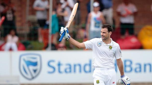 South African batsman Stephen Cook (R) raises his bat as he celebrates after scoring his century against Sri Lanka.(AFP)