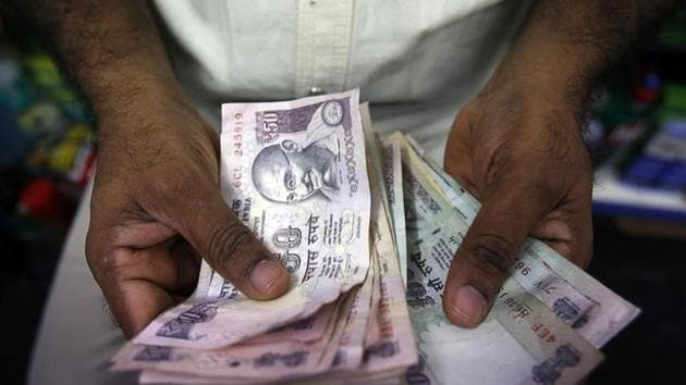 Indo-Canadians could be left sitting on crores of useless cash in the New Year.(Reuters)