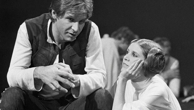 Harrison Ford talks with Carrie Fisher during a break in the filming of the CBS-TV special 'The Star Wars Holiday' in Los Angeles.(AP File Photo)