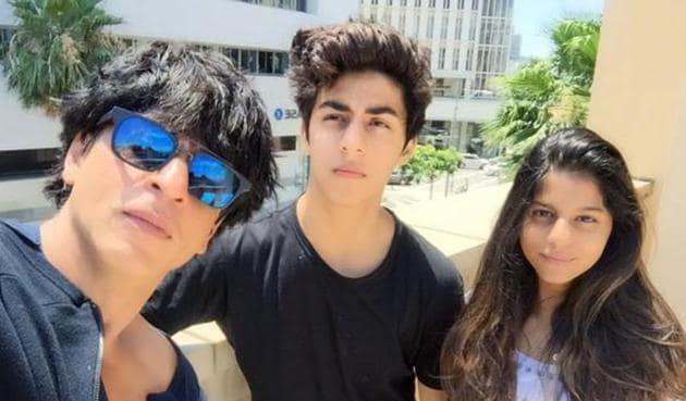 (L-R) Actor Shah Rukh with his son Aryan (19) and daughter Suhana (16).