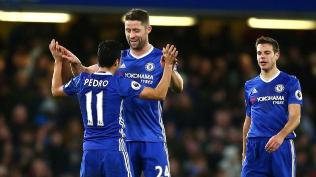Chelsea F.C. have won 12 consecutive games in the Premier League and they will be aiming to overhaul Arsenal's long-standing record of 14 consecutive wins.(Getty Images)