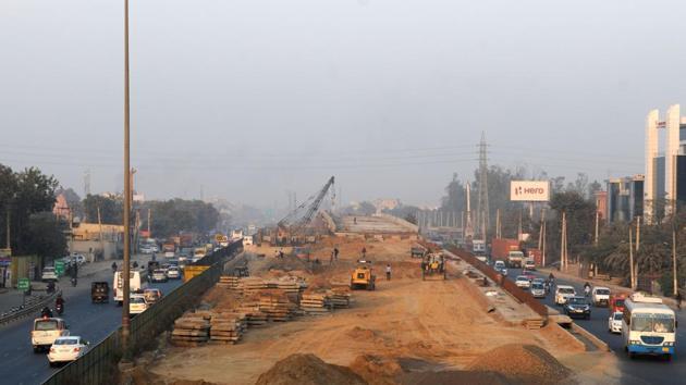 The construction of a flyover is progressing at Hero Honda Chowk.(Parveen Kumar/HT Photo)