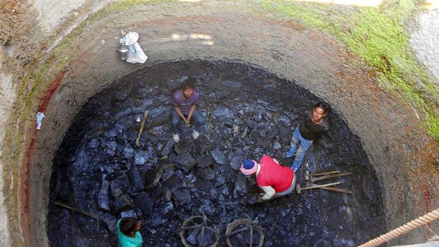 Chhotelal Yadav, a beneficiary under MGNREGA , finds coal deposit after digging around 16 foot(HT Photo)