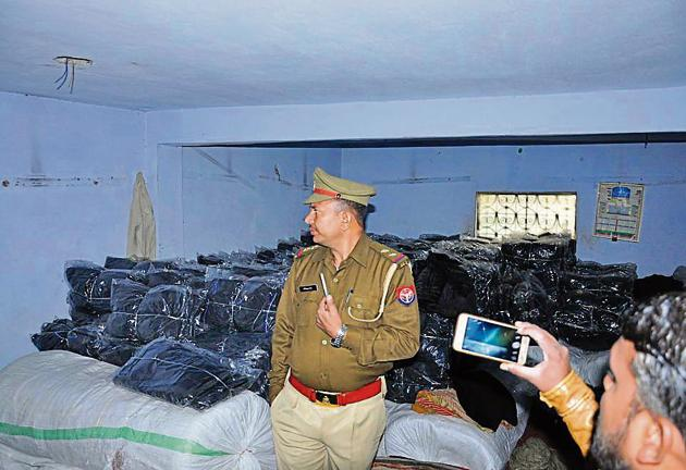 The police and the district administration officials sealed six illegal factories and snapped electricity connection of factories involved in power theft on Thursday.(HT Photo)