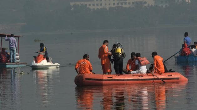 A disaster management team conducting a rescue operation at Powai lake on Saturday.(HT File Photo)