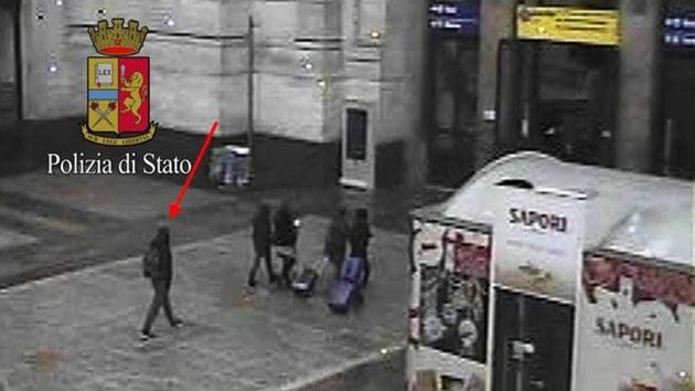 Anis Amri (L), the Tunisian suspect of the Berlin Christmas market attack, is seen in this photo taken from security cameras at the Milan Central Train Station in downtown Milan, Italy.(Reuters)