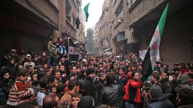 Syrian demonstrators gather in the rebel-held town of Saqba, on the eastern outskirts of the capital Damascus, during a demonstration in solidarity with the inhabitants of the embattled Syrian city of Aleppo on December 16, 2016.(AFP)