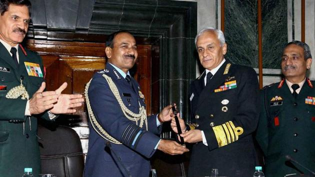 Chief of Naval Staff, Admiral Sunil Lanba received the Chairman's Chief of Staff Committee (COSC) baton from outgoing Chief of Air Staff, Air Chief Marshal Arup Raha at a ceremony in New Delhi on Thursday.(PTI)