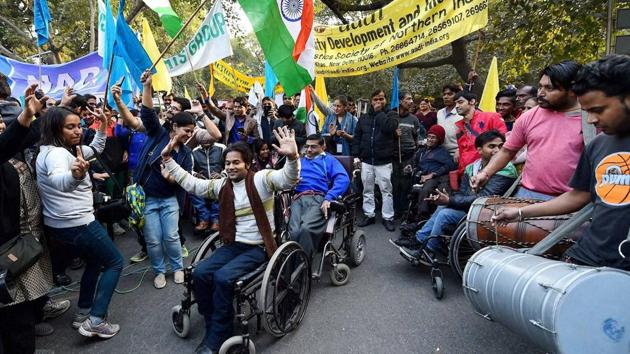 Disabled people celebrate the passage of The Rights of Persons with Disabilities Bill, 2016 by the Lok Sabha, in New Delhi.(PTI file photo)