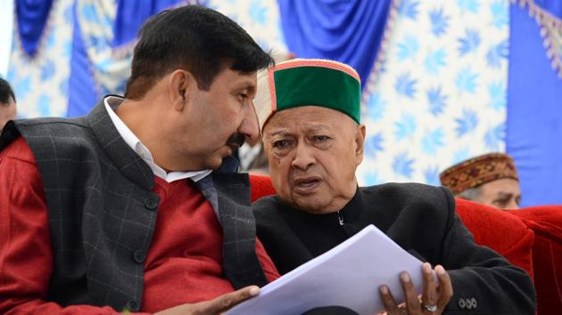 Chief Minister Virbhadra Singh and industries minister Mukesh Agnihotri during the pensioner's day event in Shimla.(HT File Photo)